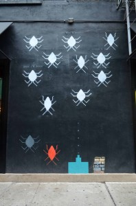 This minimalistic piece references Space Invaders, a famous arcade game during the 1980s and a feature of that era's popular culture. Photo taken with a Nikon D7000.