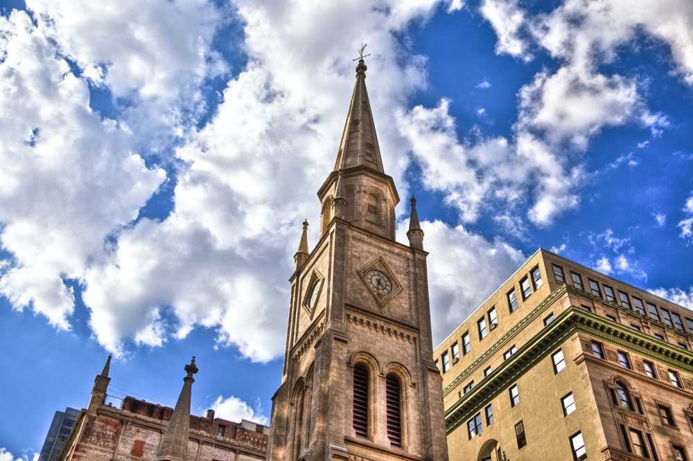 A HDR photo of Marble Collegiate Church taken on a clear and cloudy day.
