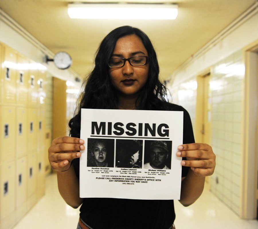 Arifa Abid '17 holds a missing persons flier that was distributed before The Blair Witch Project Premiere.