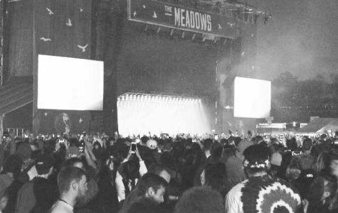 Kanye West performing at the Meadows concert.