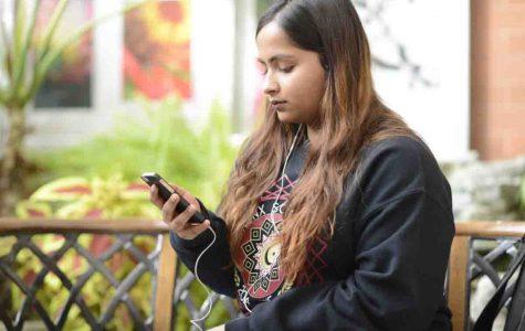 Tasfia Alam '17 listening to J. Cole's latest album.