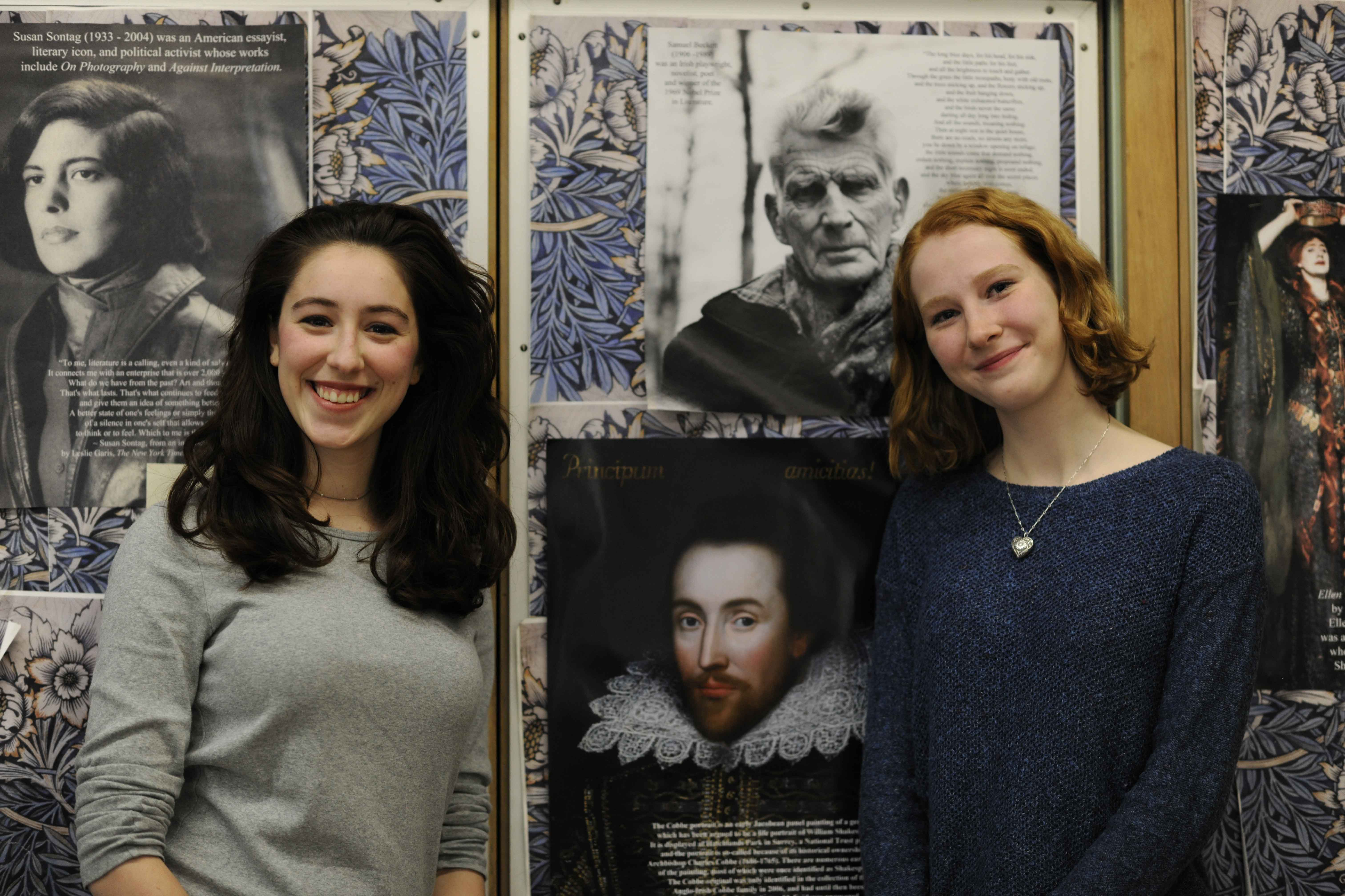 Ava Vercesi '19 (runner-up, on left) and Georgia Kester '17 (winner, on right), stand in front of a print of the newly discovered Cobbe portrait of William Shakespeare.