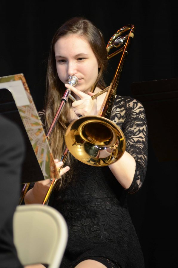 Eden Augustine '18 plays the trombone with the Jazz Band during the Winter Concert.
