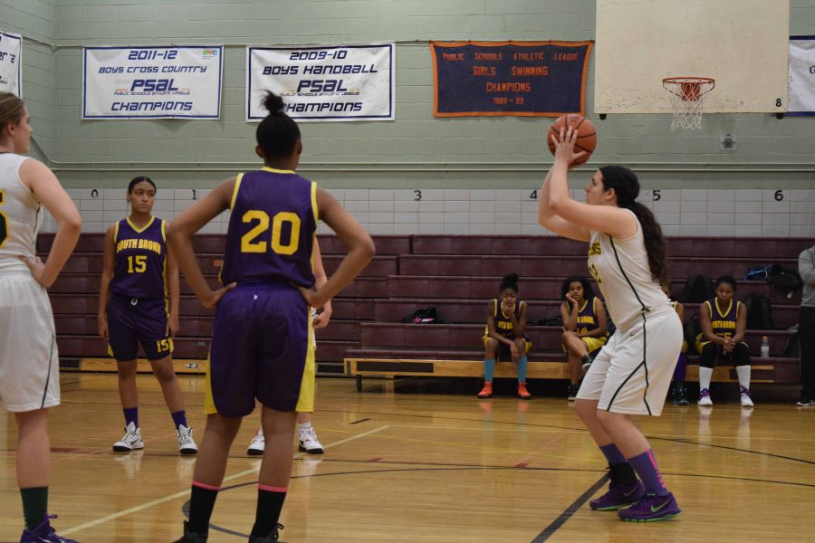 Jenna Kolodny '17' makes an ambitious shot at the foul line as the rest of the players observe her do so during a Girls' Varsity Basketball game. Some of the success of the team this season is attributable to the team's managers.
