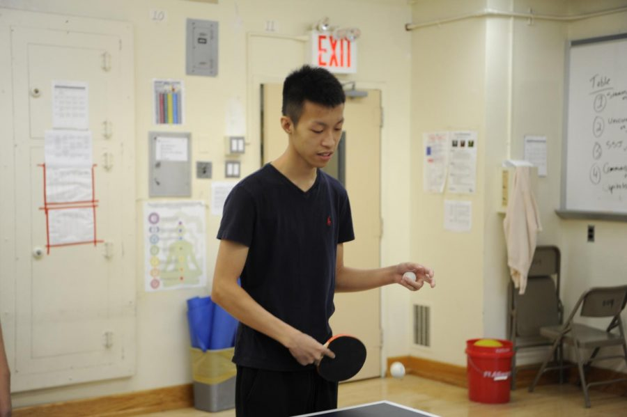 Anthony Jin '18 serves a table tennis ball