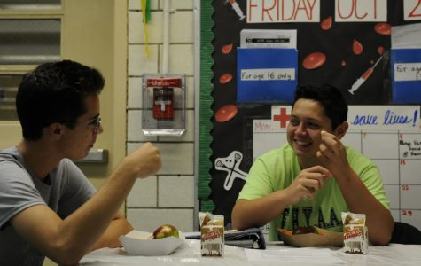 """Eytan Stanton '19 (pictured left) and Matthew Burke '18 (pictured right) enjoy the """"Free Lunch for All"""" initiative launched at the beginning of the 2017-2018 school year."""
