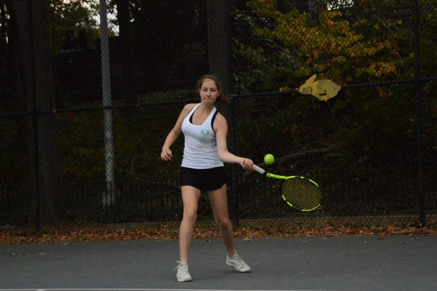 Brett Zakheim '19 hits the ball, using a cross-court forehand, to her opposing player during a Girls' Varsity Tennis match.