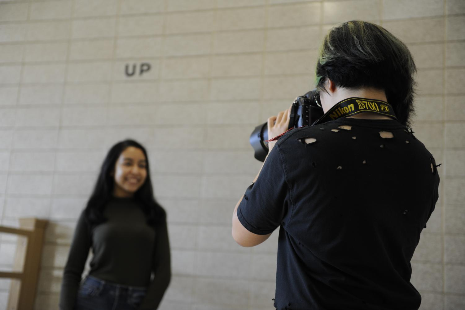 Alexis Pan '19 photographs Tahira Hasan '19 for a HoBS post.