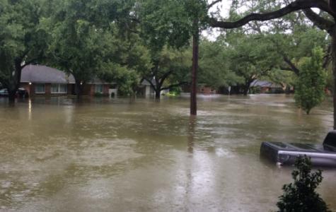 Floods brought on by Hurricane Harvey engulf a neighborhood in Houston.