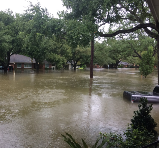 Floods brought on by Hurricane Harvey engulf a neighborhood in Houston.