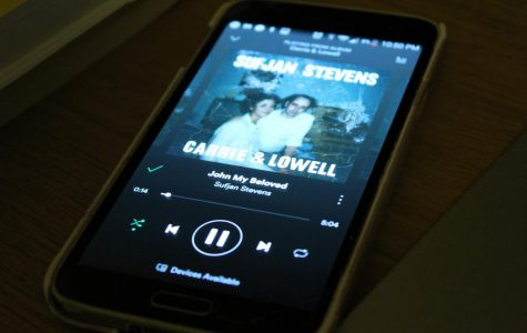 """A phone plays the track """"John My Beloved"""" off of the album 'Carrie & Lowell.'"""