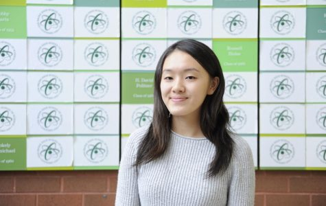 Senior Amy Gu '18 is interviewed for the new iPhone X.
