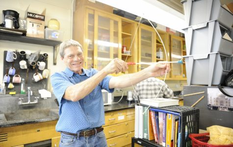Mr. Lawrence is all smiles as he shows the joy of wielding a bow and arrow.