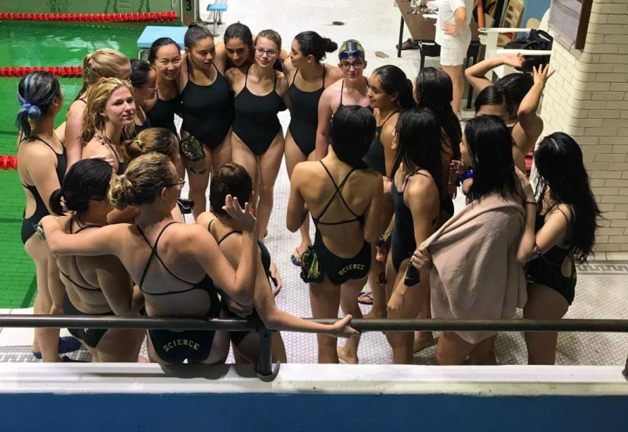 The 2017-18 girls swim team prepares for a meet by starting off with a classic cheer