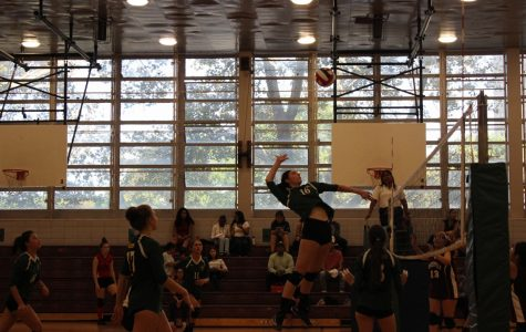 Audra Berg '18 spikes the ball during a Girls' Volleyball game against Roosevelt Educational.