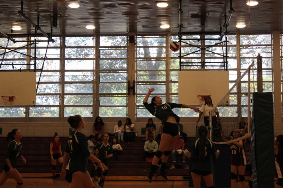 Audra+Berg+%2718+spikes+the+ball+during+a+Girls%27+Volleyball+game+against+Roosevelt+Educational.