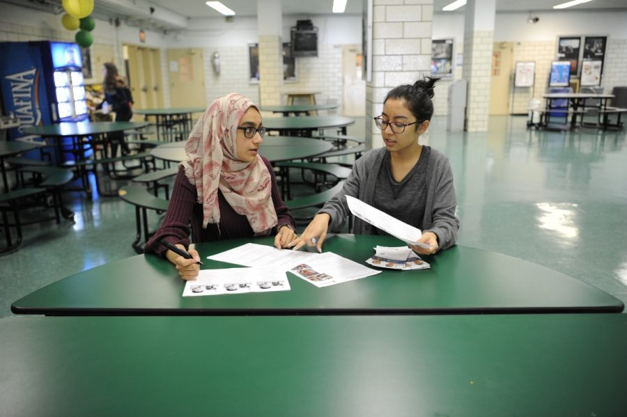 S.O. Coordinators Ayesha Khan '20 and Tahira Hasan '19 work together to promote the Blood Drive.
