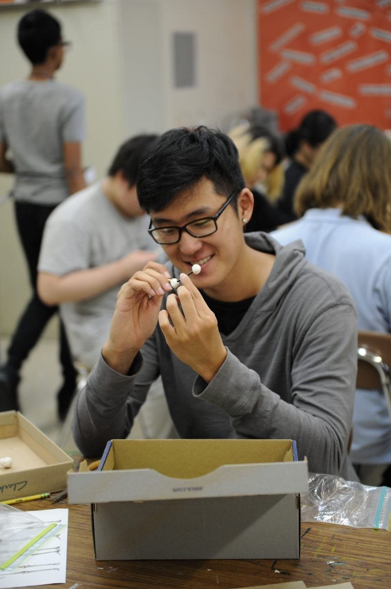 A Bronx Science student creating a sculpture during an art class.