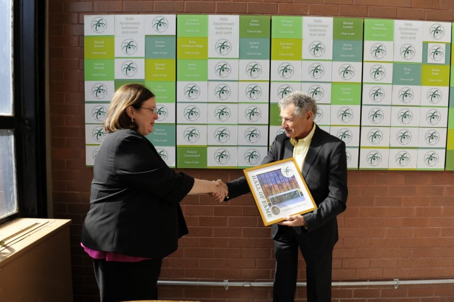 Alumnus Leonard Kleinrock accepts his award from Principal Donahue.