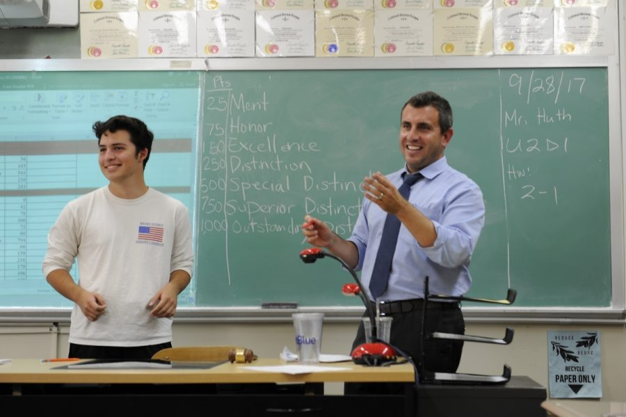 Michael and Mr. Huth explain a strategy to get the maximum amount of points for the team.