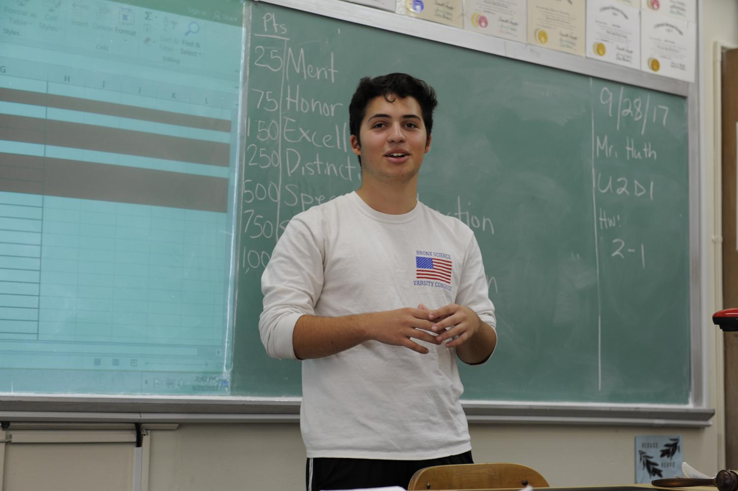 Michael Miller '18 leads the Debate Leadership class during 9th period.
