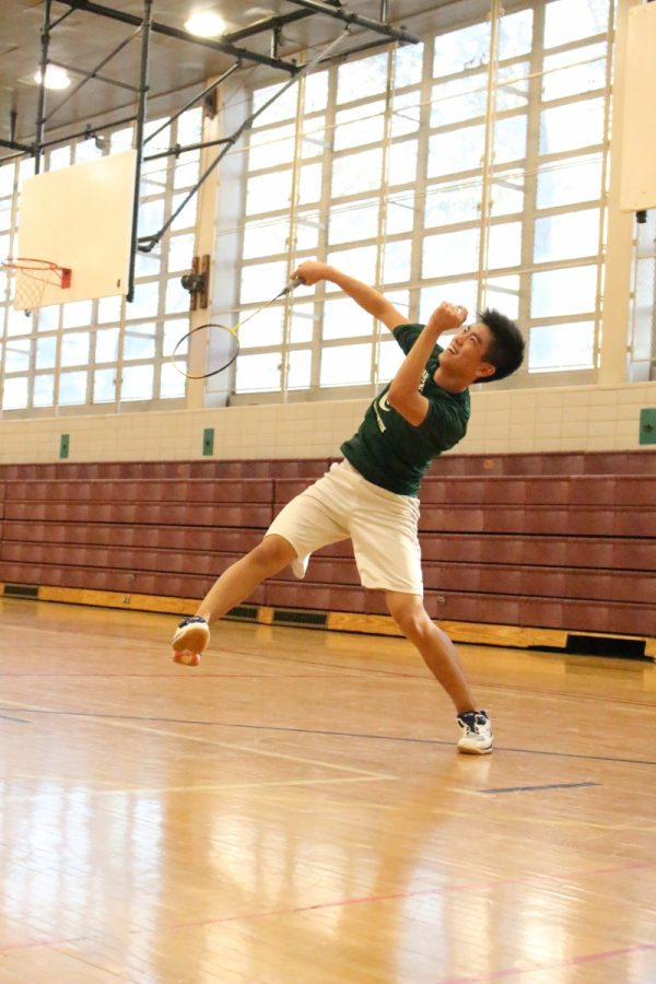 Webber Qu '19, returns a hit from an opposing team member during a Boys' Varsity Badminton match.