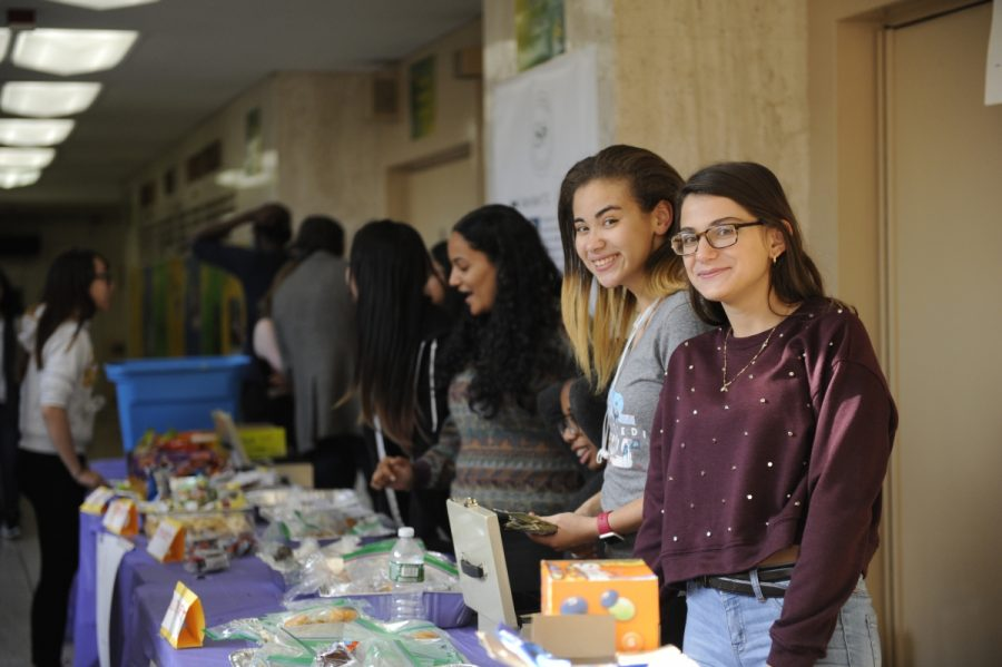 Sabrina Raouf '18, Puerto Rican student and Student Organization President, and Artea Brahaj '19 take part in an S.O. bake sale that gave its proceeds to victims of natural disasters, namely Puerto Ricans.
