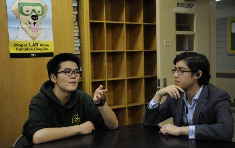 Senior Masato Hirakata discusses his stance on the movement with Anton Weintraub '18 during their free period.