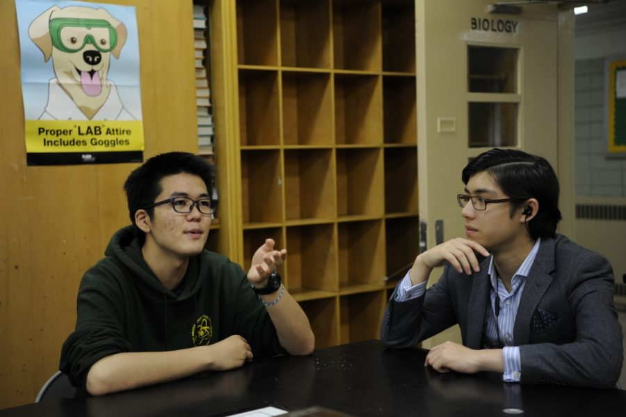 Senior Masato Hirakata discusses his stance on the movement with Anton Weintraub '18 during their free period.