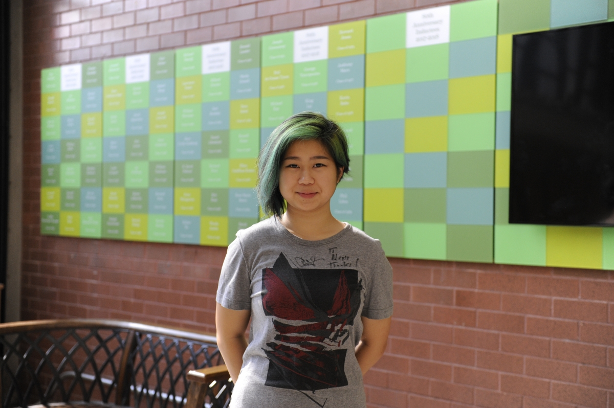 Alexis Pan '17 wearing the autographed t-shirt that Chester Bennington gave her in 2015.
