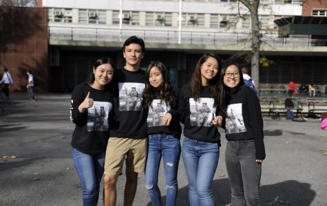 Seniors gathered with their friend in the courtyard as they took group photos of their matching shirts.