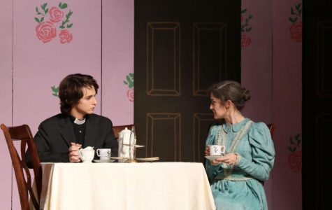 Reverend Harper, played by Joseph West '18, chats with Abby Brewster, played Caroline Gallagher '19 about the reverend's daughter and Abby's nephew, Mortimer, over tea.