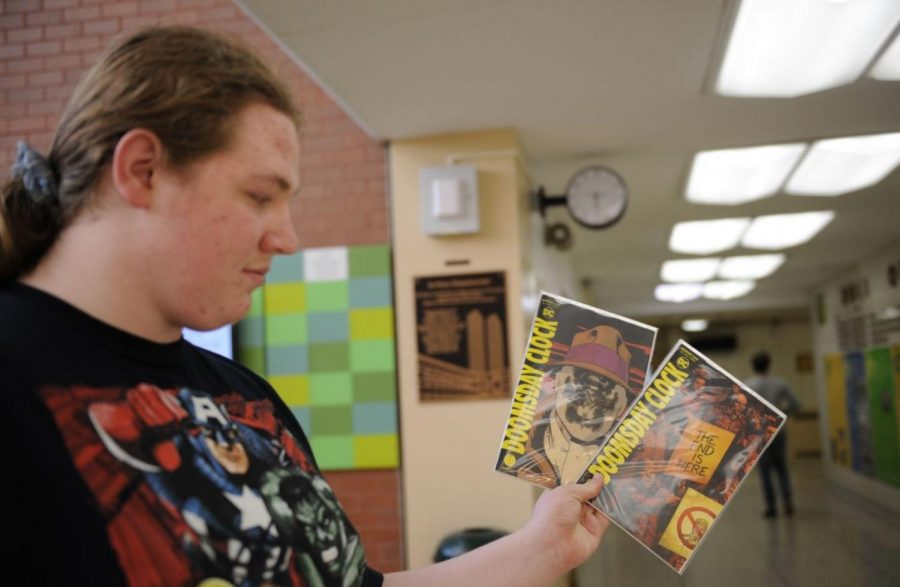 Gearod Murphy '19, looks over two covers of the new Doomsday Clock series.