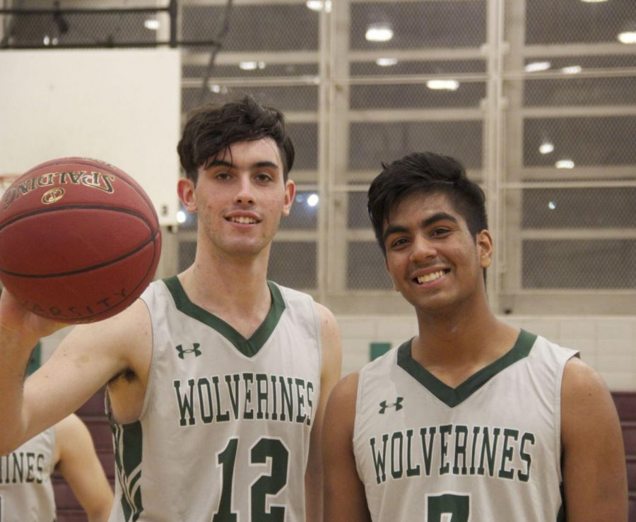 Jake Goldsmith '19 and Sheikh Hasin '19, both knick supporters, warm up for a basketball game on the Bronx Science Boys' Basketball Varsity team.