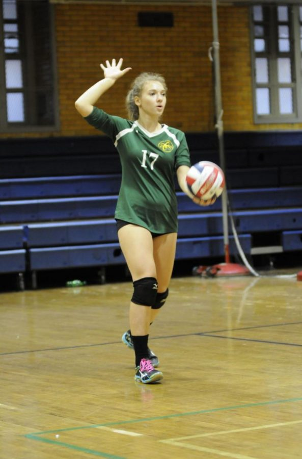 Member of the Varsity Volleyball team, senior Kateryna Slinchenkova gets ready to serve the ball to their opposing team