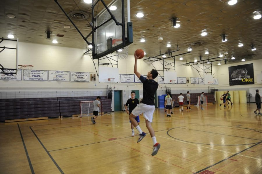 Several members of the Boys' Varsity Basketball team prepare for an upcoming game.