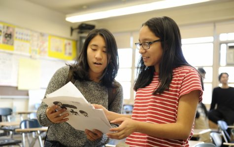 East Asian Entertainment Club President Jessica Jimenez '20 fervently discusses new K-pop groups in club meeting with Jiwon Yi '20.