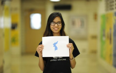Reporter Lakhsmi Chatterjee '18 holding the Korean Unification Flag.