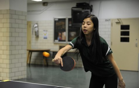 Athena Ding '19 focusing on the table tennis game