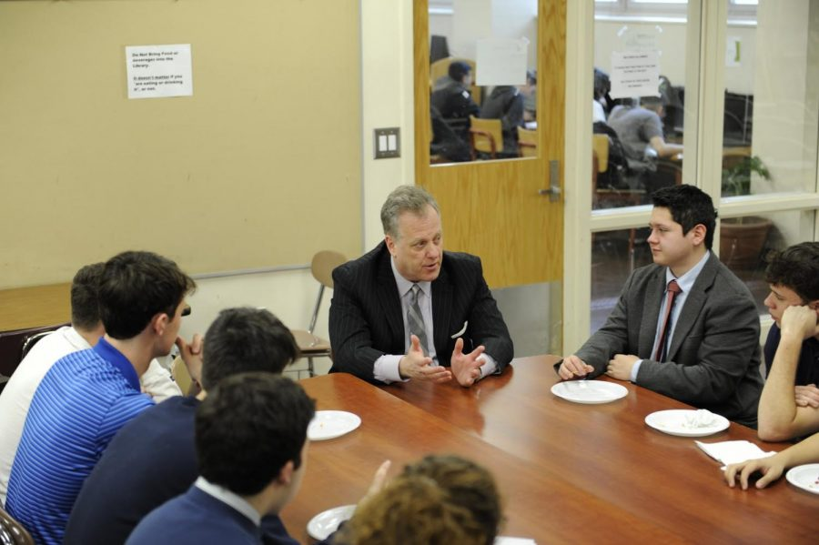 Michael Kay speaks to students about his experiences at Bronx Science during a luncheon.