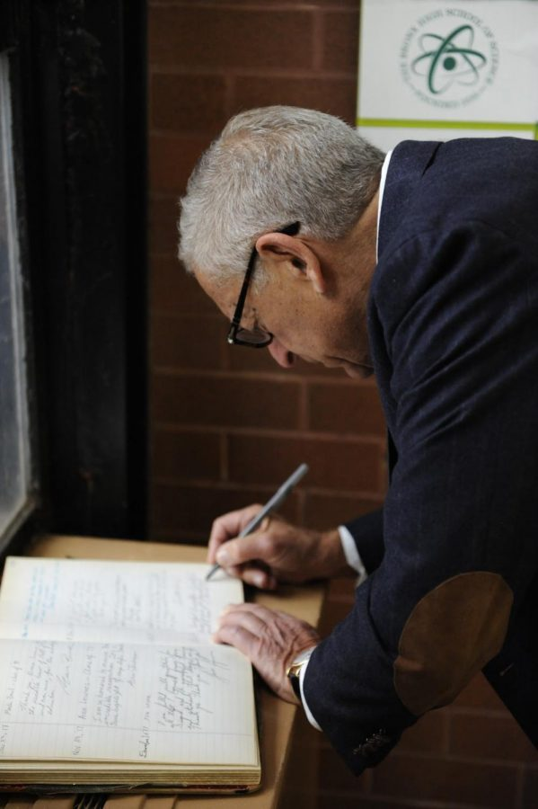 Brodsky signs the Book of Honor after his induction ceremony.