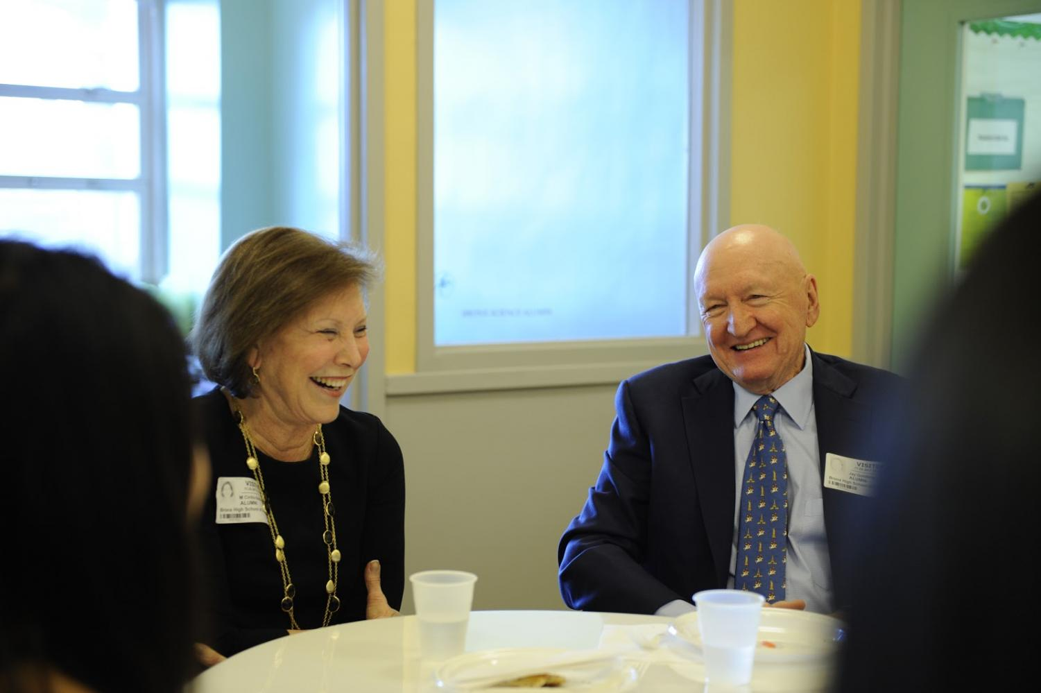 Jay Goldberg '58 and Maqry Cirillo '65 laugh while reflecting on their time attending Bronx Science