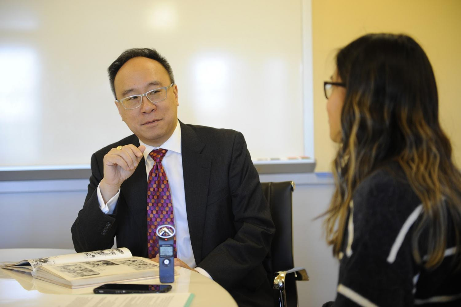 Kristina Ang '18 holds a one-on-one interview with King Lai in the Alumni office.