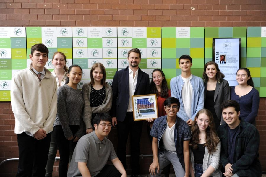 Mr. Boal is joined by students in front of the Bronx High School of Science's newly made  Hall of Fame.