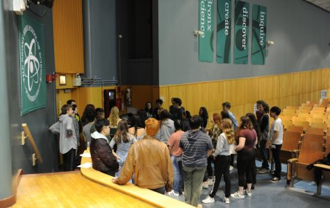 Cast members of the Spring Musical discuss their choreography during rehearsal.