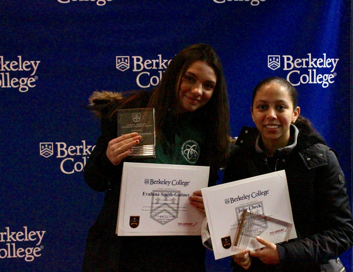 Evaluna Smithgartner '20 (left) and Julia Check '21 (right) proudly hold up their awards.