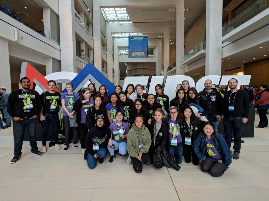 The FeMaidens and their mentors pose proudly at the FIRST Robotics National Championships in Detroit, Michigan.