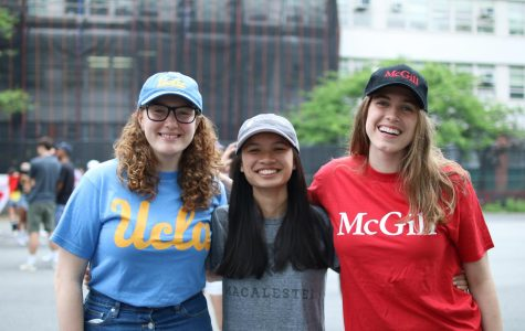 Seniors Fiona Sullivan, Anna Leidner, and Georgia McKay wear their college t-shirts and hats to participate in College Apparel Day.