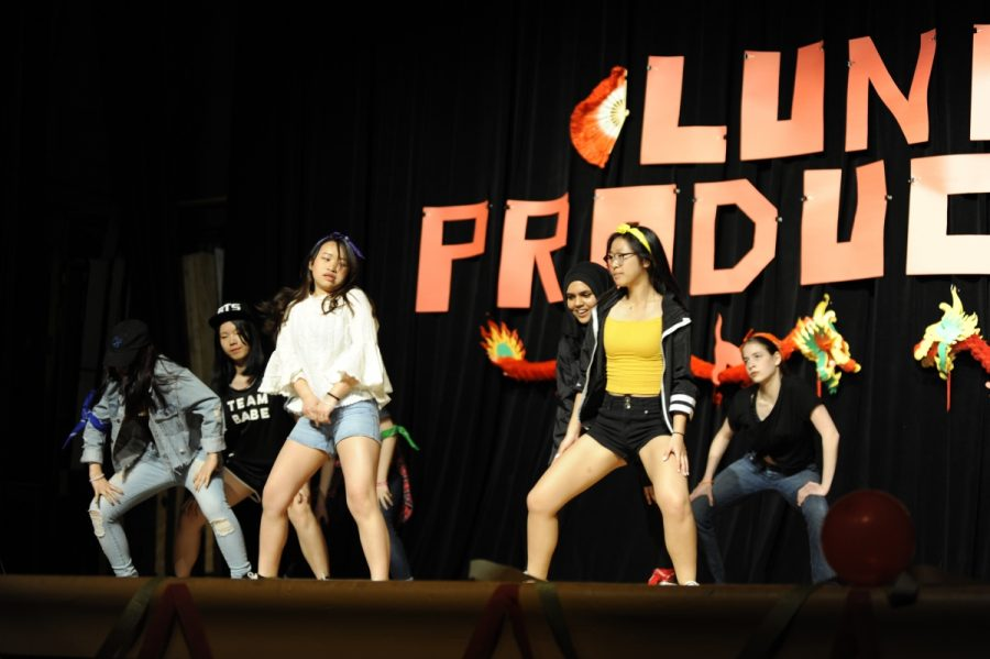 The Infinity group performing 'GoGo' by BTS during the Lunar New Year Productions performance.