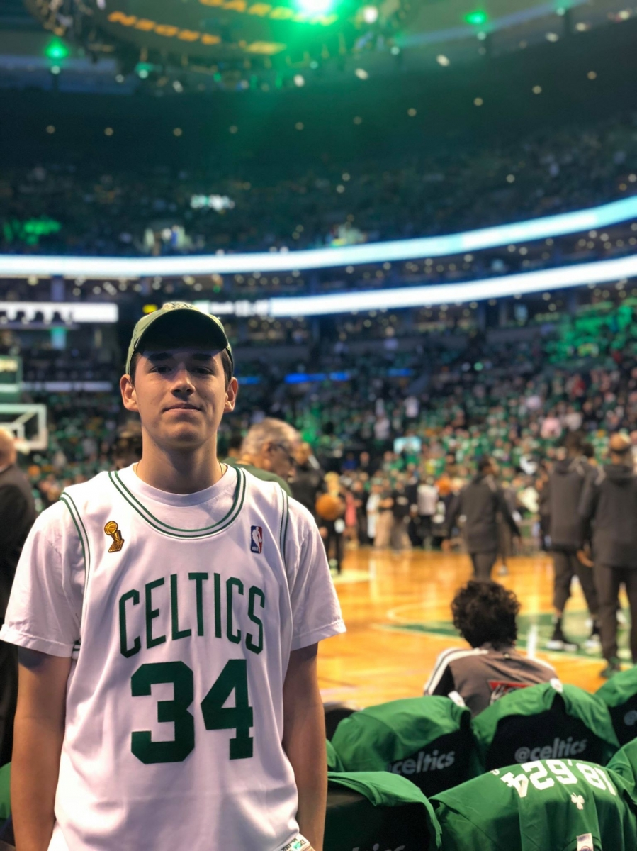 For avid Celtics fans like Lucio Vainesman '18,  the NBA playoffs are at a completely new level compared to the regular season. Vainesman is shown posing at Game 1 of the Celtics vs. Bucks matchup of the 2018 NBA playoffs.